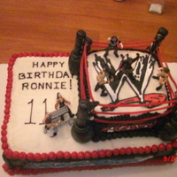 Wrestling Wwe Birthday Cake birthday cake for an 11 year old boy. Everything is edible except for the figures. The ropes are licerice and the poles are cherry sticks...