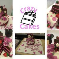 Minnie Mouse missing slice cake with fondant strawberries and hand sculpted minnie mouse - no molds!Chocolate cake with strawberry buttercream...