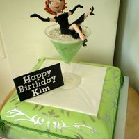 Green Martini A little sugar girl on a lime green and silver hand painted mud cake cushion
