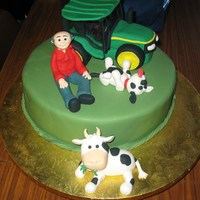 My Dad's Birthday Tractor, dad, cow & dog made out of gumpaste.Choc mud cake with vanilla buttercreamHe loved it, still has the figures and the tractor (...