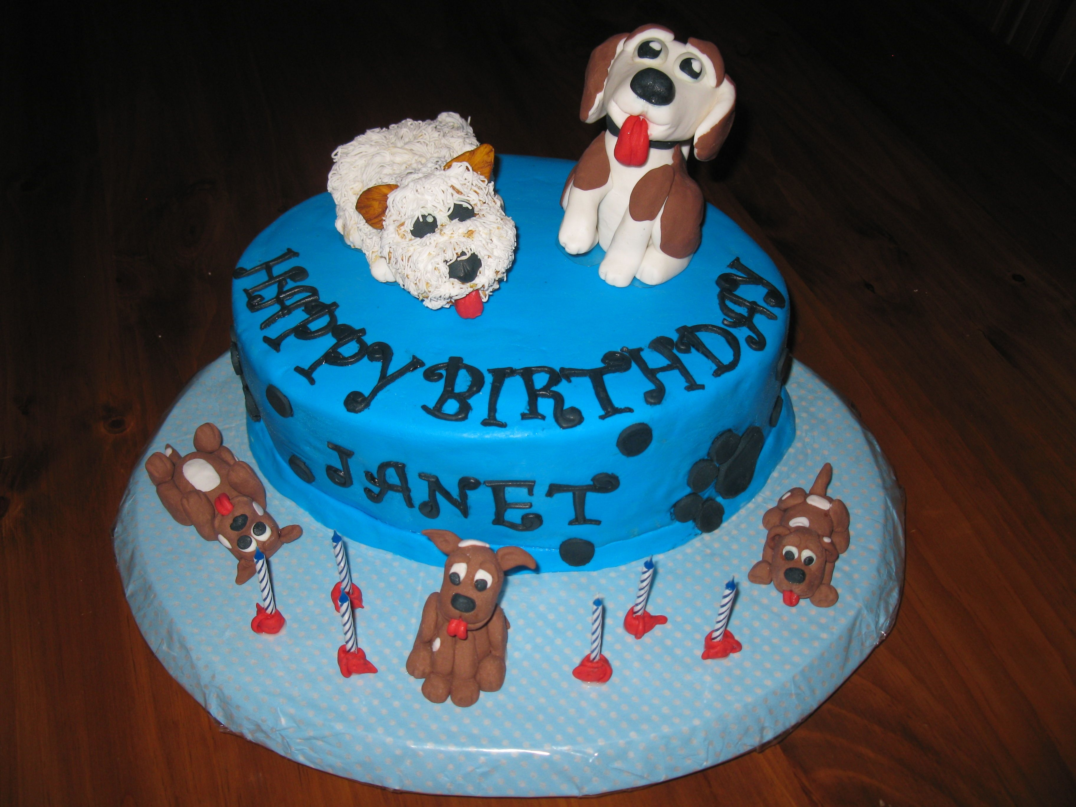 Dog Themed B'day Cake This is my second cake item to sell. The person I made this cake for has two dogs like to one's on top of the cake. The candles have...