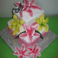 Lily Cake This cake is a chocolate mud cake with vanilla buttercream.Decorated with sugarpaste lillies and a single royal icing butterfly I made this...
