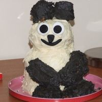 Cute Panda cake was done in a 6inch round and bowl, the head and limbs were RKT, and face is fondant.