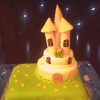 Shrek Castle a losse interpretation for a friends birthday. 6 inch, 8 inch and 12 by 9 inch victoria sponges with vanilla bc, covered in fonant. towers...