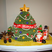 Christmas Birthday Cake  This cake is for a birthday party at a roller rink. The birthday girl wanted a Christmas themed cake since her birthday is in December. All...