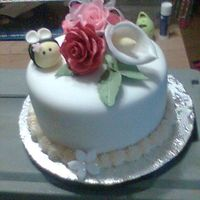 Round With Gum Paste Roses A small cake to cheer up a coworker. The little fondant bee made her laugh!6 inch Chocolate WASC covered in Serious-cakes buttercream and...