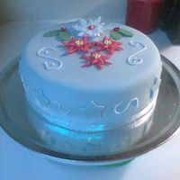 Christmas Cake One of my first fondant covered cakes using Michele Fosters fondant recipe and my first time making royal icing poinsettias. My cakes are...