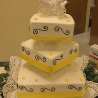 3 Tier Yellow & Black Wedd. Cake   3 tier square wedding cake with ribbon around each bottom tier and scrolls on it.