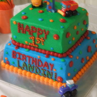 2 Tier 1St Bday Cake W/ Cars On It   2 tier square w/ buttercream icing