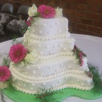 Gerber Daisy Paisley Cake   White cake with buttercream icing.Real flowers.Board covered in fondant.