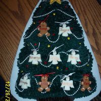 Christmas Family Tree  A friend wanted this cake for her grandparent's Christmas Anniversary. The angels (girl children), gingerbread boys (boy children),...