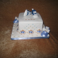 Baby Boy Converse Shower Cake  Cake is coconut with alternating layers of lemon filling and coconut cream filling. Both shoes made using CC templates. Converse shoes made...