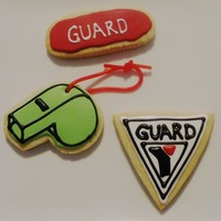 Lifeguard Cookies Sugar cookie with glaze icing. Templates used to handcut shapes. My daughter is now hooked on cookie decorating too!