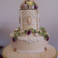 Vineyard Themed Wedding Cake  This is actually a dummy cake make for cake camp this year. Theme is sugar art in the vinyard. All gumpaste flowers, grapes and leaves,...