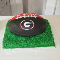 Ga Bulldogs GA Bulldogs grooms cake. Chocolate chip amaretto poundcake with buttercream filling and Satin Ice Fondant. This is sitting on a marble...