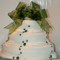 Bridalshower Cake In White And Green Pearmousse, White chocolate mousse and sugarpaste, weddings themecolour was green.