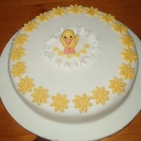 Easter Cake Plain sponge covered in orange buttercream and fondant. The chick and flowers are made out of fondant