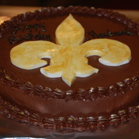 Saints Chocolate icing with fondant fleur de lis. I used the powder dust to accent.