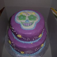 Emma's Skull Birthday Cake Day of the dead-esque birthday cake for my 10 yr old, she likes bright colors and skulls and gave me free reign over her birthday cake, so...