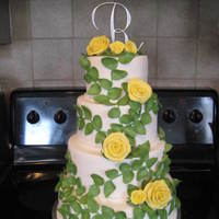 Leaves And Roses  My second wedding cake. The leaves are all handmade and dusted, there are about 200 of them. The roses were also handmade. Very fun cake to...
