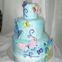 Butterfly Cake   Pretty birthday cake covered in fondant and decorated with gumpaste butterflies and hand painted swirls :)