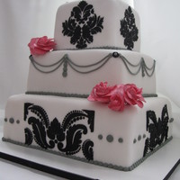 Black And White Cake  This was for my friend's wedding. The stenciling with black icing was tricky but in the end I think it was worth anxiety lol. The...