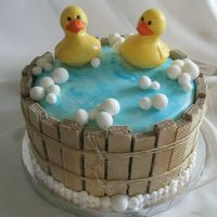 Ducky Cake Personally one of my favorites, this cake was made for parents-to-be expecting twins. This cake is covered in fondant, the barrel is made...