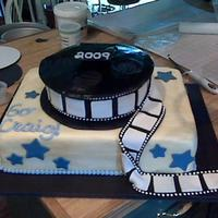 Film Reel This cake was made for my cousin who is studying film in college. Cake is decorated with fondant, gumpaste and royal icing.
