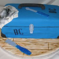 "Toolbox Cake  My BF's dad is a contractor and every tool he owns has a spray painted ""BC"", so for his birthday we made him a toolbox in..."