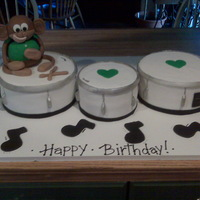 Marching Band Drums This cake was made using fondant and the monkey was made with rice krispy treats and also covered in fondant. Thanks for looking!