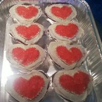 Heart - Shaped Cupcakes These are red velvet cupcakes iced in Wilton's recipe cream cheese icing. I used a cookie cutter and red sugars to make the heart...