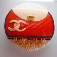 Chanel Clutch Purse I used a 10 inch round cake pan to make this cake. The original design was supposed to be an orange Coach purse but I was messing up on the...