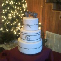 3 Tier Fondant Covered Wedding Cake With Forest Green Accents  This is my first fondant covered multi-tier wedding cake. Top and Bottom tiers were Funfetti WASC, and middle tier was a plain WASC. All 3...