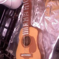 Acoustic Guitar  Fondant covered German chocolate WASC cake with pecan coconut filling and a chocolate buttercream. Some accents were made using 60% cocoa...