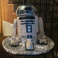 R2-D2   This groom cake was a chocolate WASC cake with chocolate mousse filling and chocolate buttercream icing, covered with fondant.