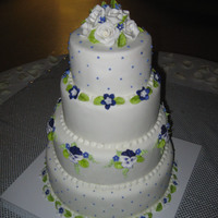 Wedding Cake With Purple Pansies I love pansies, so I was thrilled when the bride and groom wanted a purple and white wedding cake.