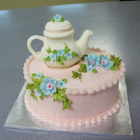 Teapot Cake This was a little oval cake I made for a friend's b-day. She loves teapots so I thought it would be perfect. The teapot is made out of...