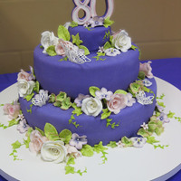 Purple Passion This was a cake for my mother-in-law;s 80th birthday. She loves purple, so purple it is! She also loves butterflies so we had to have a few...