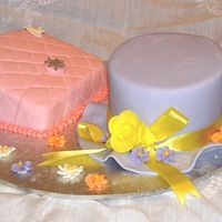 Hat & Purse Cake   Fondant covered cakes with gumpaste and royal icing piped flowers.