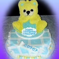 Christening Cake Wilton teddy bear iced in buttercream on round cake iced in fondant.