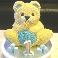 Teddy Bear 1St Birthday Cake Teddy bear cake using wilton stand up bear tin, buttercream icing.