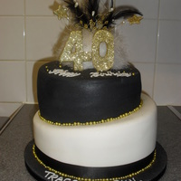 Black White Gold Topsy Turvy Cake i love this cake! i love contrasting cakes and the white black and gold just really work together!