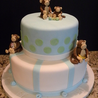 Monkey Themed Baby Shower Cake 2 tier Baby Shower Cake, covered with fondant. Monkey's are made with 50/50 gumpaste/fondant paste. Enjoy!