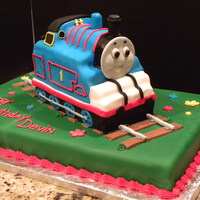 Thomas The Train This Thomas the Train cake was made for a 4 year old! He loved it! Thomas is made with yellow pound cake and covered in Fondant. The track...