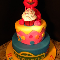 Elmo! 2 tier fondant covered cake. Elmo is made with Rkt. Elmo cutouts are made from fondant and cut out using the cricut cake. Thanks for...