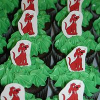 Clifford Cupcake Parade Triple Chocolate Cupcakes covered with cream chease buttercream!!! and a handmade clifford Toothpick decoration!! thanks for looking!!!