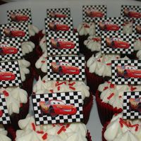 Cars Cupcake Parade triple chocolate cupcakes covered with cream chease buttercream and topped with a handmade toothpick of lightning McQueen.Thanks for...