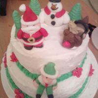 Christmas Winter Fun! Santa, Rudolph, Elf, and Frosty fondant 3D characters on top of a two tier dulce de leche cake.