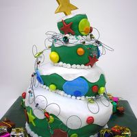 Christmas Tree I enjoyed making this cake very much.Made in Fondant and used jewelry. Thank you for viewing.