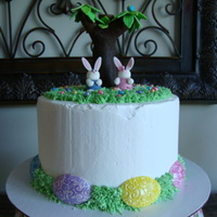 Easter Bunnies Fondant bunnies - rice krispie tree covered with fondant - fondant eggs on top and sides